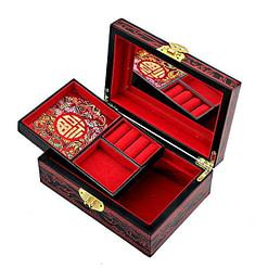 Boîte rouge ouverte présentant miroir et plateau amovible