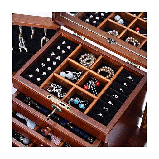 les tiroirs et le compartiment supérieur sont montrés ouverts