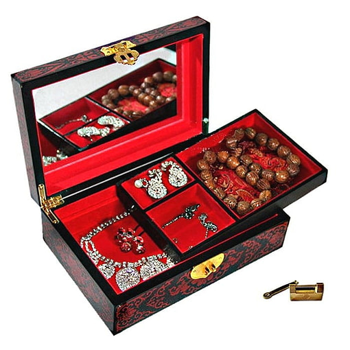 Boîte à bijoux originale 'lotus' rouge ouverte, plateau supérieur déposé avec bijoux