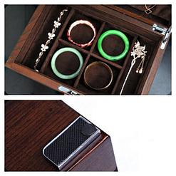 Détails de la boîte à bijoux en bois compartimentée (patin et intérieur)