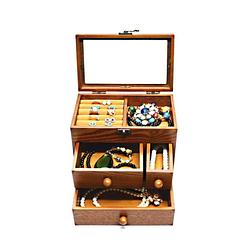 Vue de face de la boîte à bijoux en bois tiroirs et verre ouverte et avec bijoux