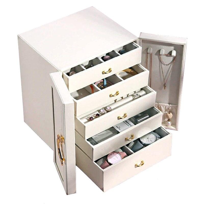 Vue de 3/4 de la boîte à bijoux avec portes cuir blanc (ouverte, avec bijoux)